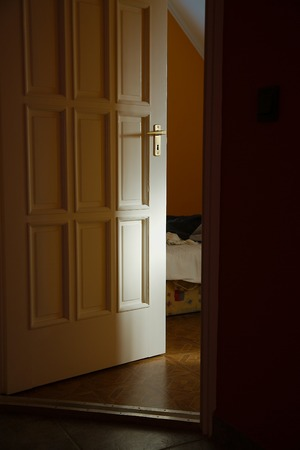 ajar: Light coming from a room with door left ajar Stock Photo