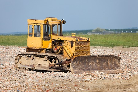 destruct: Old dozer at a construction site