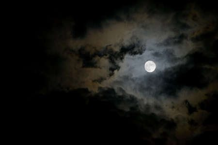 dark cloud: Dark stormy sky with moon