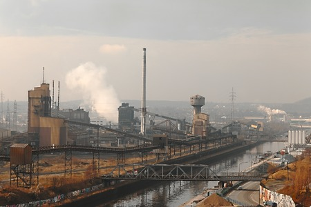 Old, dirty industrial district with smog photo