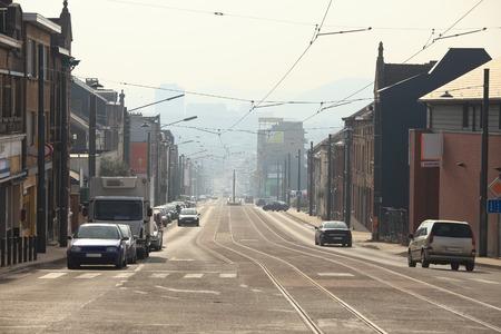 urbanized: Urban street with smoggy view in Belgium