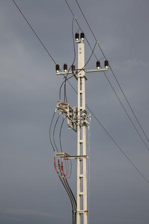 stomy: Electric line column with stomy sky