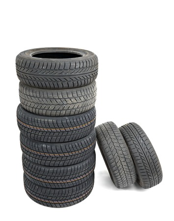 Many car tyres in a pile photo