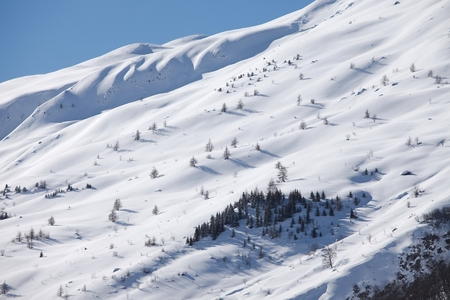 Snowy mountains in winter weather photo