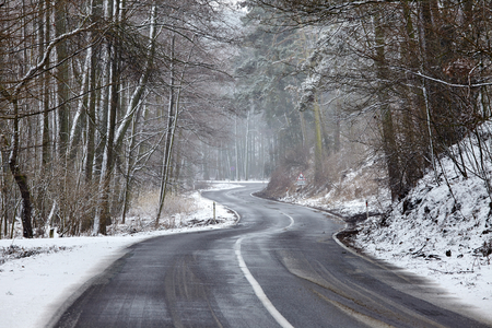 Snowy road in winter landscape photo
