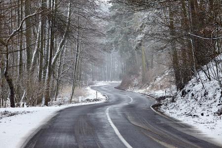 Snowy road in winter landscape photo