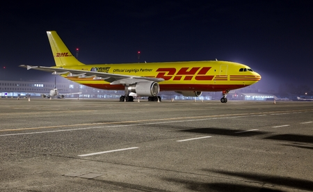 world market: BUDAPEST, HUNGARY - MARCH 5: DHL Airbus A300 cargo plane at Budapest Airport, March 5th 2014. DHL is a world market leader in air mail Editorial