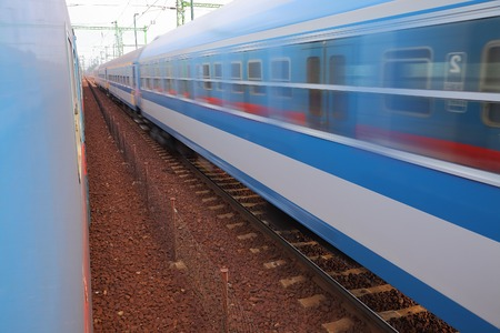 Trains pass by with motion blur photo