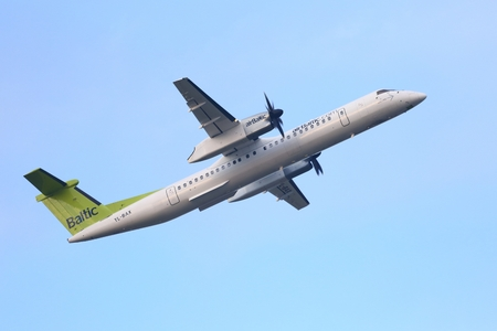 bombardier: BUDAPEST, HUNGARY - OCTOBER 18: AirBaltic Dash 8 taking off at Budapest Airport, October 18th 2014. AirBaltic  operates daily flight between Budapest and its base, Riga.