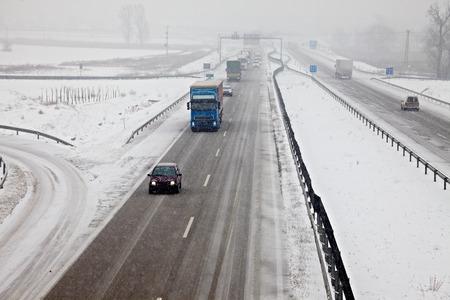 Highway traffic in heavy snowfall photo