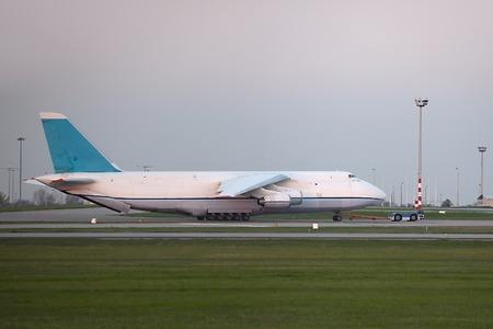 towed: Huge cargo plane being towed