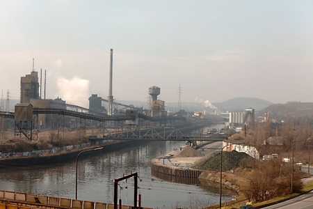 energy channels: Old, dirty industrial district with smoke