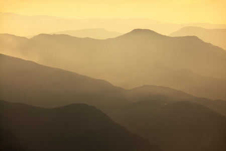 distant: High mountain landscape in hazy weather Stock Photo