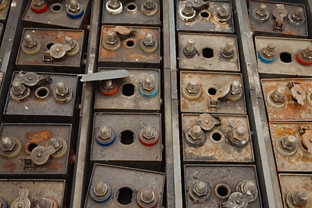 electrolyte: Old batteries of a tram rusting in warehouse Stock Photo