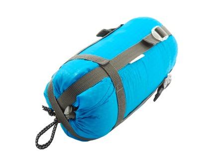sleeping bag: Sleeping bag packed on white background