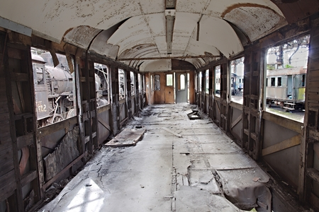 abandoned car: Abandoned train carriage with interior falling apart Stock Photo