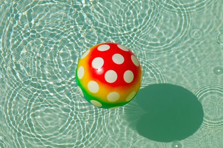 rubber ball: Rubber ball with spots in water Stock Photo