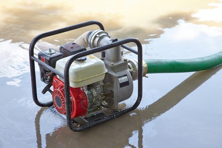 pumping: Pumping out water from a flooded area
