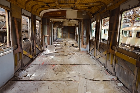 apart: Abandoned train carriage with interior falling apart Stock Photo