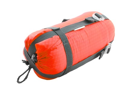 red bag: Sleeping bag packed on white background