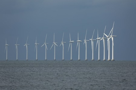 wind power plant: Offshore wind turbines at the sea in Copenhagen, Denmark Stock Photo