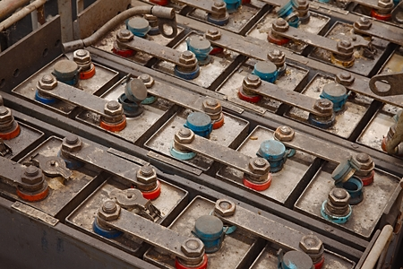 power equipment: Old batteries of a tram rusting in warehouse Stock Photo
