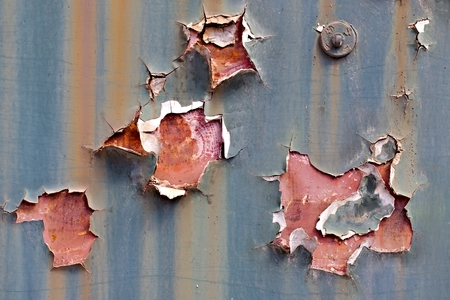 falling apart: Texture of paintwork falling apart on metal surface