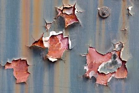 falling apart: Texture of paintwork falling apart on metal surface