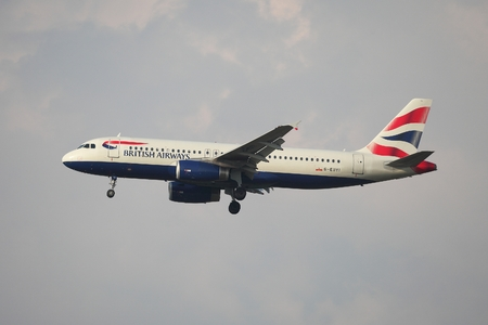 kastrup: COPENHAGEN, DENMARK - MAY 13: British Airways A320 approaching Kastrup Airport, May 13th 2015. British Airways if the flag carrier airline of the United Kingdom.