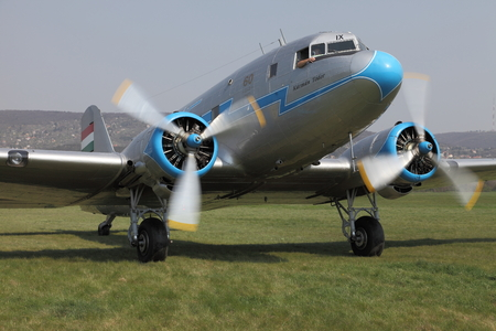 65 years old: BUDAORS, HUNGARY - APRIL 27: Li-2 aircraft starting engines on 27th April, 2014. This aircraft is 65 years old. Editorial