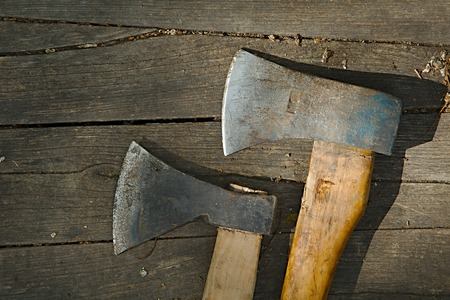axes: Two axes on a wooden surface