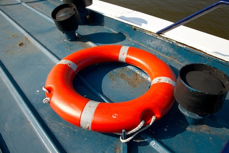 onboard: Lifebuoy in a dock by the water Stock Photo