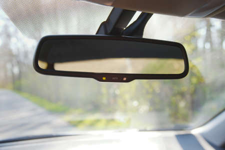 on mirrors: Rear view mirror of a car