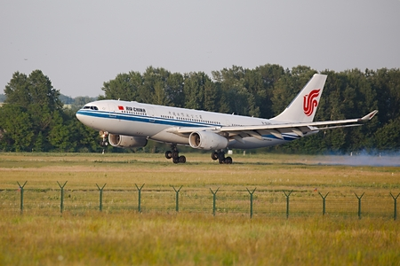 jetplane: BUDAPEST, HUNGARY - MAY 31, 2015: Air China Airbus A330 landing at Budapest Liszt Ferenc Airport.