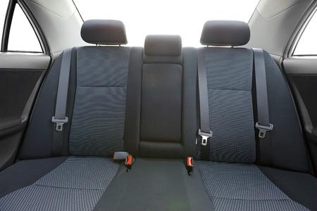 cinturon seguridad: Interior del coche con los asientos traseros, la luz del sol quema a través
