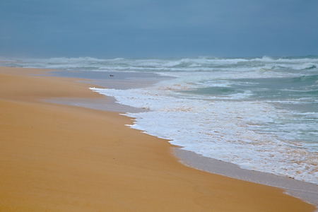 sandy beach: Sandy beach with big waves