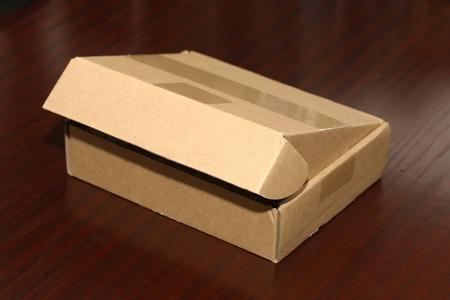 ebay: Open cardboard box on a table