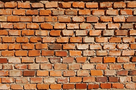 Bare brick wall texture closeup photo