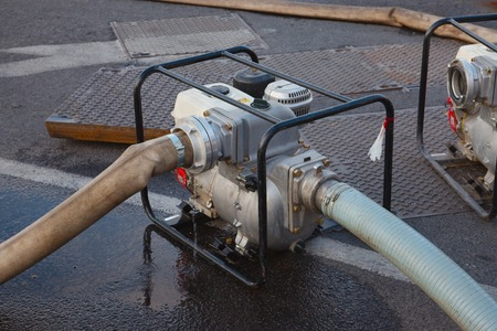 out of water: Pumping out water from a flooded area