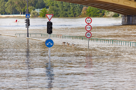 inundated: Flooded street n Budapest with traffic sign Stock Photo