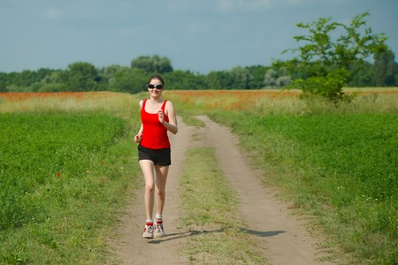 dirtroad: Jogging in the countyside in sunny weather
