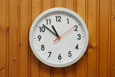 Analogue clock on the wall Stock Photo