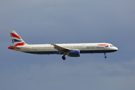 kastrup: COPENHAGEN, DENMARK - MAY 13: British Airways A321 approaching Kastrup Airport, May 13th 2015. British Airways if the flag carrier airline of the United Kingdom.