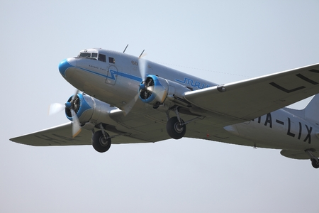65 years old: BUDAORS, HUNGARY - APRIL 27: Li-2 aircraft climbing on 27th April, 2014. This aircraft is 65 years old. Editorial