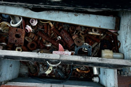 corrode: Rusty metal tools in an abandoned drawer Stock Photo