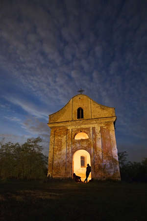 pillage: Spooky chapel with silhouettes at the entrance Stock Photo
