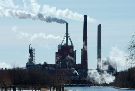 energy crisis: Smoke rises from a big industrial plant Editorial