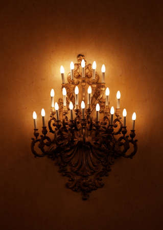 castle interior: Decorated chandelier in palace hall Stock Photo
