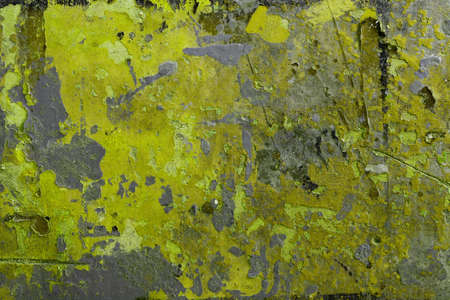 apart: Rough texture of painted surface falling apart