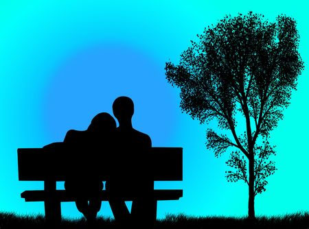 Lovers on the bench in front of a colorful sunset photo